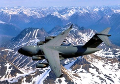 249th Airlift Squadron – Boeing C-17A over the Alaska Range