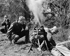 Arlington State College ROTC students firing a mortar during a field exercise, circa 1950s