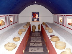 Reconstruction of a mithraeum with a mosaic depicting the grades of initiation