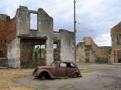 Burned out cars and buildings still litter the remains of the original village in Oradour-sur-Glane, as left by Das Reich SS division