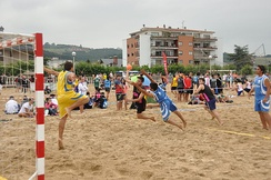 Goal shot in a men's beach handball game