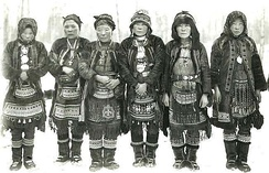 Even women in ethnic costume, early 20th century.