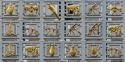 "The ""Gilded Vectors of Disease"" on the front of the building"