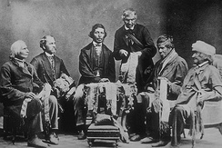 Iroquois Chiefs from the Six Nations Reserve reading Wampum belts in Brantford, Ontario in 1871. Joseph Snow, Onondaga chief, is first on the left.