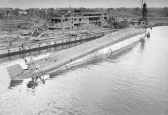 The German cruiser Admiral Scheer capsized in the docks at Kiel after being hit in a RAF raid on the night of 9/10 April 1945