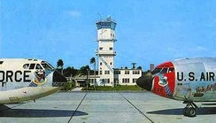 Postcard from McCoy AFB in the early 1960s, showing the McCoy AFB control tower and base operations building, Boeing B-52D-5-BW Stratofortress, AF Ser. No. 55-5054, and Boeing KC-135A-BN Stratotanker, AF Ser. No. 57-1506, of the 4047th Strategic Wing.