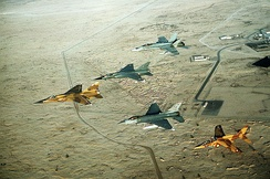 A multinational fighter formation, including, left to right, a Qatari F-1 Mirage, a French F-1C Mirage, a U.S. Air Force F-16C Fighting Falcon, a Canadian CF/A-18A Hornet and a Qatari Alpha Jet, during Operation Desert Shield