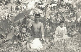 Hawaiian man with his two children, circa 1890.