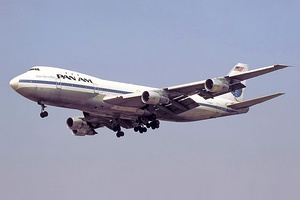 A Pan Am 747-100 in white and blue livery during final approach with its landing gear extended. The aircraft is N732PA, the third 747 built and an aircraft that was used in the 747 flight test program.