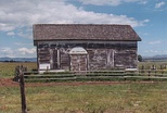 Morrisite meetinghouse visible on the west side of Interstate 90 south of Deer Lodge