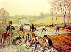 "Construction of the first macadam road in the United States (1823). In the foreground, workers are breaking stones ""so as not to exceed 6 ounces in weight or to pass a two-inch ring"".[91]"