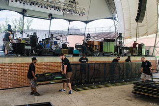 Road crews (roadies) working on the stage construction of a concert by Grace Potter and the Nocturnals at Telos Wireless Pavilion in 2013