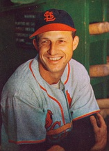 Stan Musial wearing the Cardinals' 1950s road uniform with the original navy cap and red bill.