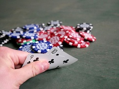 Players work to minimize the visibility of their hand to others by only turning up part of their cards