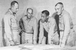 Lemuel C. Shepherd (left) speaks with members of his staff during a planning meeting prior to the Guam operation. Next to him is 1st Brigade Chief of Staff John T. Walker, Alan Shapley (4th Marines) and Merlin F. Schneider (22nd Marines)