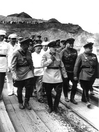 Genrikh Yagoda (middle) inspecting the construction of the Moscow-Volga canal. Behind his right shoulder is young Nikita Khrushchev.