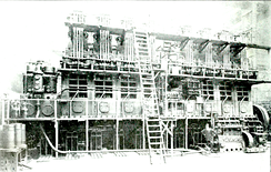 One of the eight-cylinder 3200 I.H.P. Harland and Wolff – Burmeister & Wain diesel engines installed in the motorship Glenapp. This was the highest powered diesel engine yet (1920) installed in a ship. Note man standing lower right for size comparison.