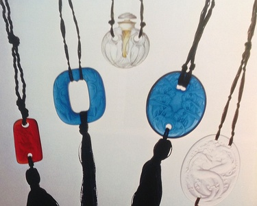 René Lalique (1925–30), molded glass pendants on silk cords