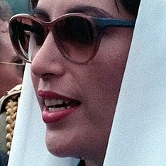 "Benazir Bhutto was the first elected female head of state in a Muslim-majority country, serving as the Prime Minister of Pakistan twice (1988-1990, 1993-1996). Nicknamed the ""Iron Lady"",[457] her December 2007 assassination was symbolic of Pakistan's early 21st century descent into chronic instability.[458] Numerous Pakistani structures – including the first international airport at Islamabad and multiple universities – have been named in her honour."