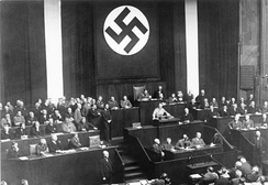 Adolf Hitler addressing the Reichstag on 23 March 1933. Seeking assent to the Enabling Act, Hitler offered the possibility of friendly co-operation, promising not to threaten the Reichstag, President, states or churches if granted the emergency powers.