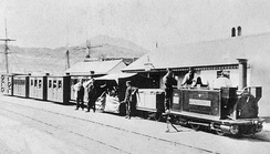 "George England locomotive ""The Princess"" with passenger train at Porthmadog harbour station circa 1870."
