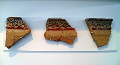 Left, fragments of ancient Macedonian painted roof tiles (raking, simas, pan-tiles), Archaeological Museum of Pella, Greece. Right, the Ionic capital of a pilaster from the palace at Pella, Archaeological Museum of Pella.