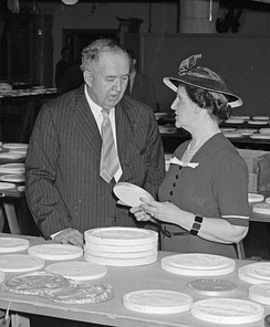 Nellie Tayloe Ross (right), Director of the Mint, and Edward Bruce, Director of the Section of Painting and Sculpture, inspect candidates for the design of the new Jefferson nickel, April 1938