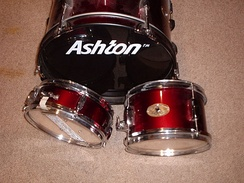 "Three-piece set for a young player: 16"" bass, 10"" snare, one 10"" hanging tom"