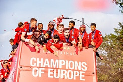 Liverpool players on an open top bus parading the Champions League trophy through the streets of Liverpool the day after the final.
