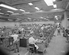 Machinists and toolmakers making experimental engine parts at the Aircraft Engine Research Laboratory, 1946.