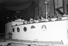 Two Tibetan delegates (front right) during the Asian Relations Conference in Delhi in 1947 as Mahatma Gandhi speaks (far left). A Tibetan flag is seen in front of them along with flags of other participating countries.