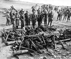 Eisenhower, Bradley and Patton inspect a cremation pyre at the Ohrdruf concentration camp on April 12, 1945, after liberation.