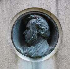 Antoine-Augustin Préault medallion on the tomb of Desnoyers in Père-Lachaise cemetery.