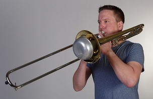 Trombonist playing with a straight mute, the most common brass mute