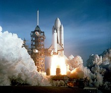 The Space Shuttle takes off on a manned mission to space.