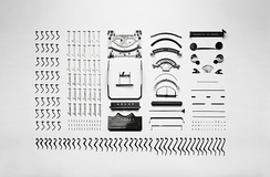 Disassembled parts of an Adler Favorit mechanical typewriter