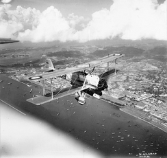 Vickers Vildebeest Mk III of No. 36 Squadron in flight over Singapore. 22 September 1936