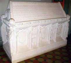 White's sarcophagus features symbols of important aspects of his life, including crests of nations where he had been an ambassador, and icons of universities where he had studied