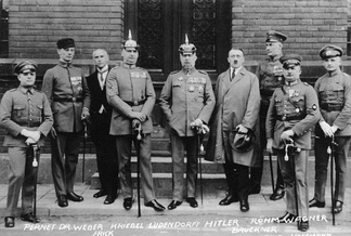 1 April 1924. Defendants in the Beer Hall Putsch trial. From left to right: Pernet, Weber, Frick, Kriebel, Ludendorff, Hitler, Bruckner, Röhm, and Wagner. Note that only two of the defendants (Hitler and Frick) were wearing civilian clothes. All those in uniform are carrying swords, indicating officer and/or aristocratic status