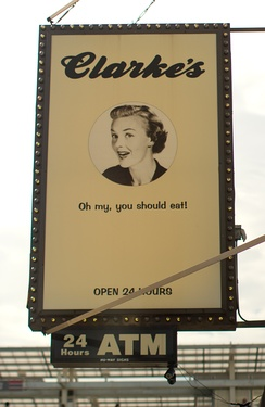 An advertisement for a diner. Such signs are common on storefronts.