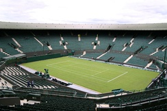 Centre Court at Wimbledon. First played in 1877, the Wimbledon Championships is the oldest tennis tournament in the world.[332]