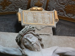 The acronym INRI (Jesus of Nazareth, King of the Jews) written in three languages, as in John 19:20,[112] Ellwangen Abbey, Germany.