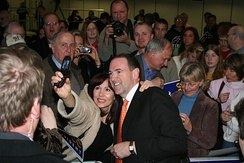 Huckabee with a supporter at a campaign rally in Wisconsin
