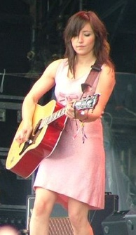 Tunstall performing at the 2005 Glastonbury Festival with her Gibson Dove guitar