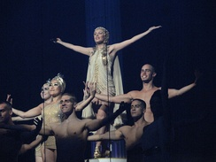 "Minogue closing her 2011 tour Aphrodite: Les Folies with a performance of the single ""All the Lovers"""