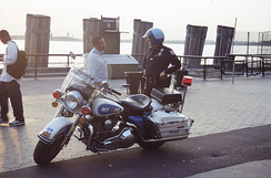 A NYPD motorcycle police officer speaks with a passerby in 2008.
