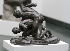 The Ancient Greek version of MMA was called the pankration. Similar to modern MMA, it freely employed wrestling techniques.