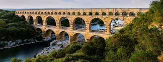 The multiple arches of the Pont du Gard in Roman Gaul (modern-day southern France). The upper tier encloses an aqueduct that carried water to Nimes in Roman times; its lower tier was expanded in the 1740s to carry a wide road across the river.