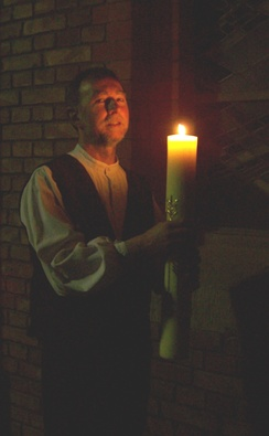 Lutheran deacon holding the Paschal candle during the Easter Vigil