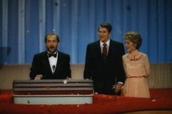 Greenwood speaking at the 1988 Republican National Convention with President Ronald Reagan and First Lady Nancy Reagan behind him